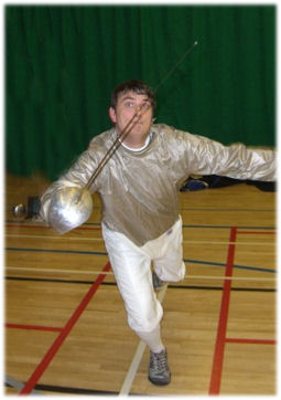 Sean Slootweg demonstrating a lunge with the sabre.